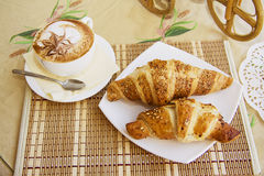 Croissants on table in cafe Royalty Free Stock Photography
