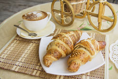 Croissants on table in cafe Royalty Free Stock Photos