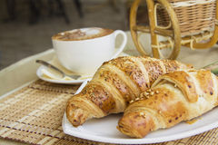 Croissants on table in cafe Royalty Free Stock Images