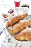 Croissants on table with jam, orange juice and coffee Royalty Free Stock Image