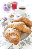 Croissants on table with jam, orange juice and coffee Stock Images
