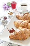 Croissants on table with jam, orange juice and coffee Royalty Free Stock Photo