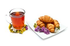 Croissants with tea Stock Images