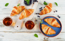 Croissants and two cups of tea Stock Photo