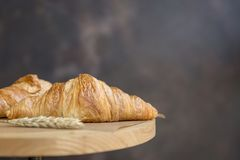 Croissants with wheat ears at dark backgorund stock image