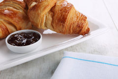 Croissants on white plate Royalty Free Stock Images