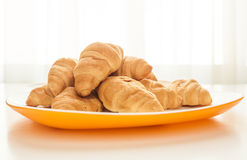 Croissants in a white plate. Mini croissants in a plate on a table with natural light Royalty Free Stock Photography