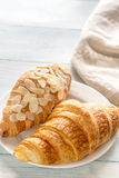 Croissants on the white plate: top view Stock Photos