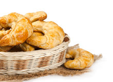Croissants in a wicker basket Stock Photos
