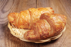 Croissants in wicker plate Stock Photography