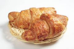 Croissants in wicker plate Royalty Free Stock Photography