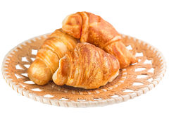 Croissants in wicker wooden plate Stock Images