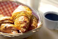 Croissants on a wooden basket Stock Photos