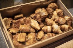 Croissants on a wooden box weave in a bakery shop royalty free stock image