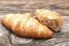 Croissants. On the wooden table royalty free stock photography