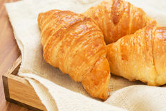 Croissants on wooden tray Stock Photo