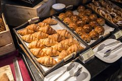 Croissants on a wooden tray. In the buffet line Royalty Free Stock Photography