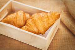 Croissants on wooden tray, filtered image Royalty Free Stock Images