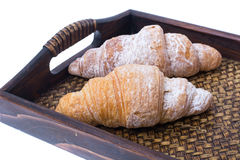 Croissants on wooden tray royalty free stock photo