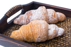 Croissants on wooden tray royalty free stock photos