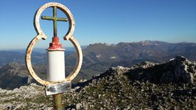 Croisse near sky. Croisse on the peak of mountain in perfect panoramic Stock Image