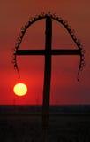 Croix au coucher du soleil Images libres de droits