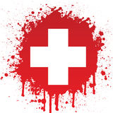 Croix blanche dans l'éclaboussure rouge Photographie stock libre de droits