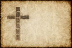 Croix chrétienne sur le parchemin Photographie stock libre de droits