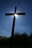 Croix contre éclairée Images stock