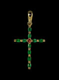 Croix d'or avec des émeraudes Images libres de droits