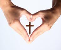 Croix dans la main Photographie stock libre de droits