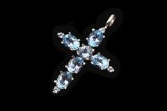 Croix de bijou avec le topaz bleu Photographie stock libre de droits