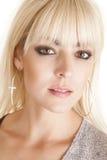 Croix de boucles d'oreille de cercle de femme Photographie stock libre de droits
