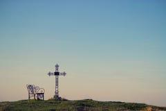 Croix de cimetière en silhouette Image stock