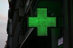 Croix de lumière d'une pharmacie Photos stock