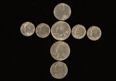croix de pièces de monnaie Photo stock