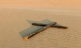 Croix de sable photo stock