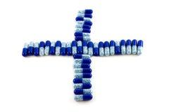 Croix des capsules photos stock