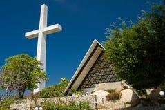 Croix et église d'Acapulco Photo stock