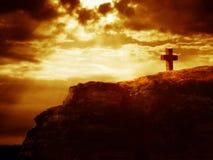 Croix sur une roche Photographie stock libre de droits