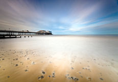 Cromer Pier. The Victorian Cromer Pier in Norfolk, UK. A long shutter speed was used the blurr the water to give it a dream like quality and lots of space for stock photo