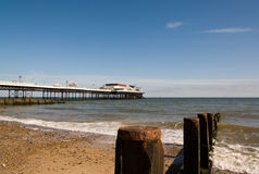 Cromer Pier. From the beach with groyne detail in the foreground royalty free stock photos