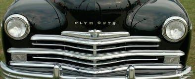 Cromo del negro de la parrilla del frente del coche de Plymouth Fotografía de archivo libre de regalías