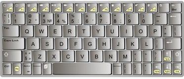 Cromo moderno con el teclado anaranjado del bluetooth del ordenador portátil aislado Imagenes de archivo