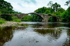 Cromwells Bridge over the River Hodder, Lancashire. Old packhorse bridge over river hodder in Lancashire. The bridge is known as Cromwell's Bridge as it was Royalty Free Stock Photo