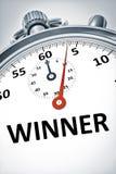 Cronómetro con el ganador del texto Foto de archivo