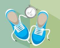 Cronómetro y zapatillas de deporte Imagen de archivo