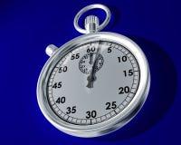 Cronômetro em um fundo azul Fotos de Stock