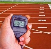 Cronômetro no campo do atletismo Imagens de Stock