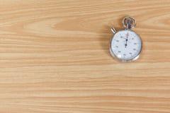 Cronômetro velho na tabela de madeira Fotos de Stock Royalty Free
